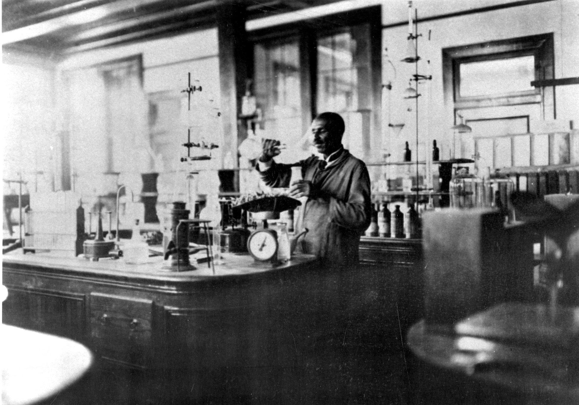 George Washington Carver at work in his laboratory